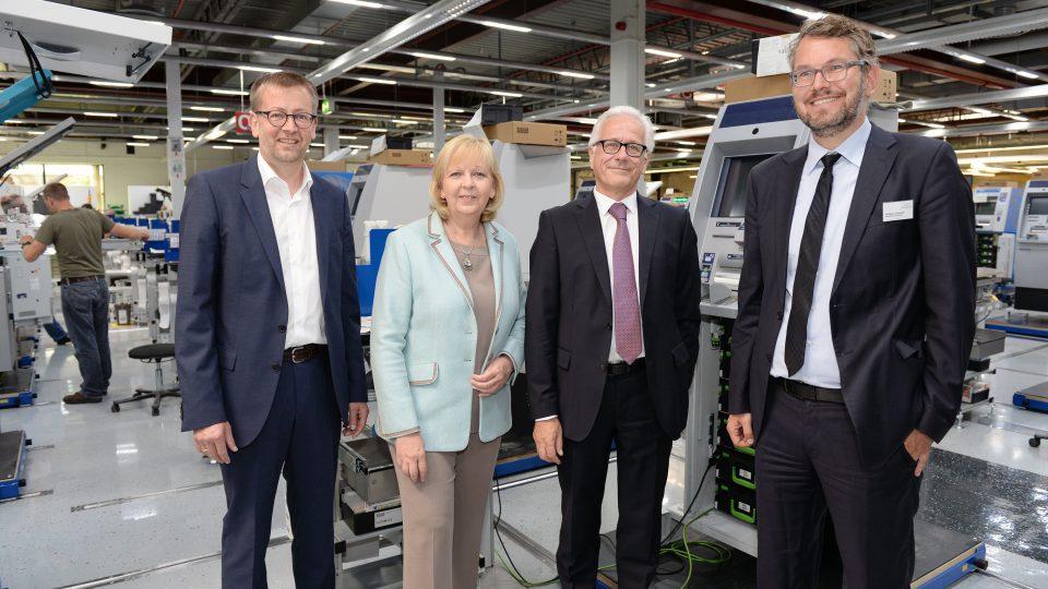 Gruppenfoto mit Ministerpräsidentin Kraft und der Geschäftsleitung