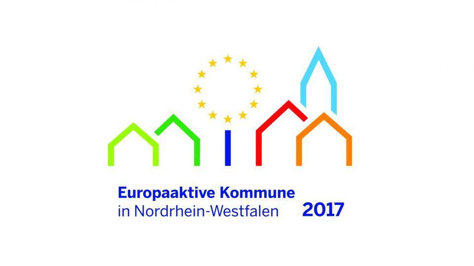 Logo der europaeischen Kommunen in NRW - Verschieden farbige Rahmen von Häusern und einem Kirchturm, in der Mitte wie ein Baum mit dunkelblauem Stamm und die Krone als Kranz aus EU-Sternen.